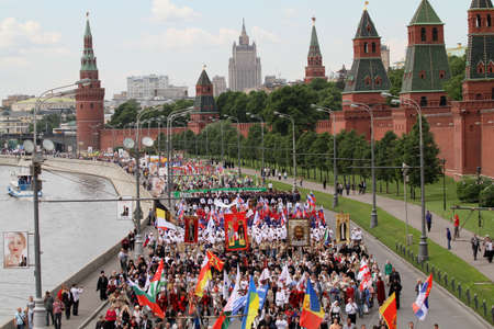 believers: MOSCOW - MAY 24: Hundreds of orthodox believers walk near the Kremlin, while celebrating the Holiday of St. Cyril and Methodius, the creators of Cyrillic alphabet, May 24, 2010 in Moscow, Russia. Editorial