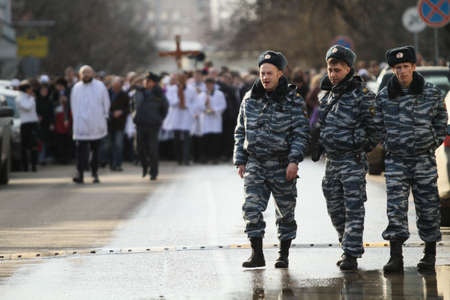Catholics walk in a procession held ahead of the Easter Holy Week, Saturday, March 25, 2010 in Moscow, Russia.