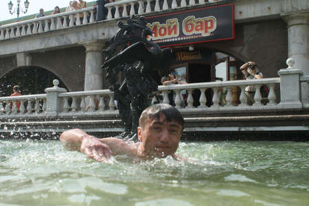 anomalous: MOSCOW - JUNE 26: Teenagers cool off in fountains on Manezh Square by the Kremlin during a anomalous heatwave, June 26, 2010 in Moscow, Russia. Editorial