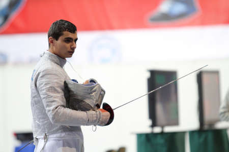 rou: MOSCOW, RUSSIA - FEBRUARY 13: Rares Dumitrescu (ROU) compete at the 2010 RFF Moscow Saber World Fencing Tournament, February 13, 2010 in Moscow, Russia. Editorial