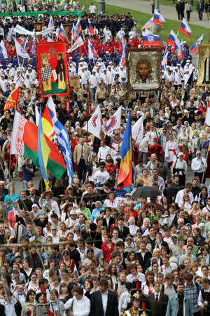 residents: MOSCOW - MAY 24: Orthodox clergymen, city authorities and residents of Moscow march along the Kremlin wall to mark the Day of the Cyrillic Alphabet, May 24, 2010 in Moscow, Russia.