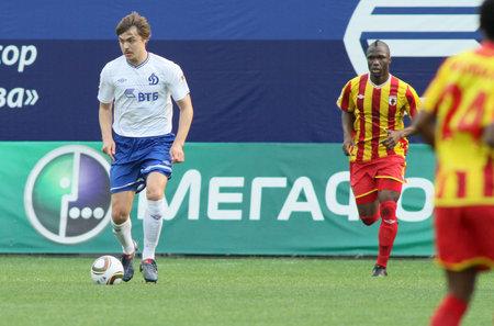 defender: MOSCOW - MAY 15: Dinamos defender Aleksandr Epurjanu (L) and Alanias defender Ibrahim Gnanou (R) in a game Dinamo Moscow vs. Alania Vladikavkaz - 2:0, May 15, 2010 in Moscow, Russia.