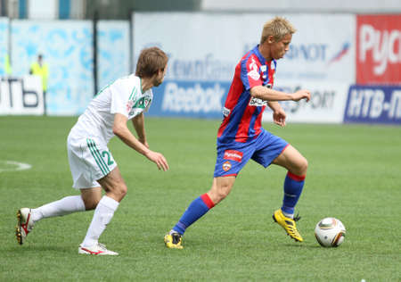 MOSCOW - MAY 10: CSKA�s Keisuke Honda (R) in action during their team�s Russian football championship game CSKA (Moscow) vs. Terek (Grozny) - (4:1), May 10, 2010 in Moscow, Russia.