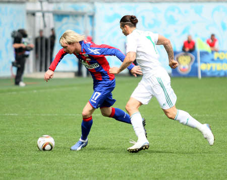 MOSCOW - MAY 10: CSKAs Milos Krasic (L) in action during their teams Russian football championship game CSKA (Moscow) vs. Terek (Grozny) - (4:1), May 10, 2010 in Moscow, Russia.