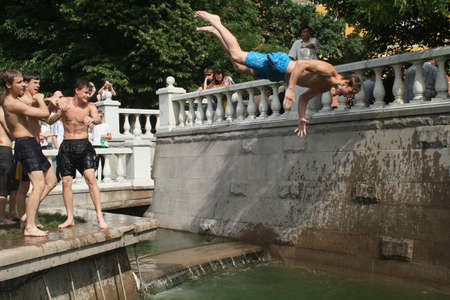 MOSCOW - JUNE 26: Teenagers cool off in fountains on Manezh Square by the Kremlin during a anomalous heatwave, June 26, 2010 in Moscow, Russia.