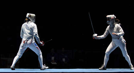 MOSCOW, RUSSIA - FEBRUARY 16: Women's national teams of France and Russia compete at the 2010 RFF Moscow Saber World Fencing Tournament, February 16, 2010 in Moscow, Russia. Stock Photo - 7738904