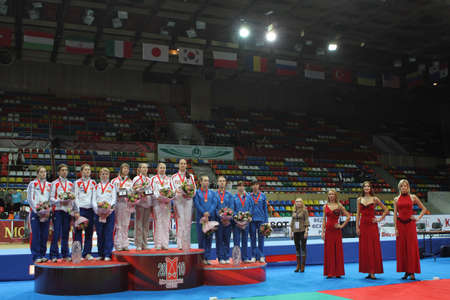 Women's national teams of Russia, France and Ukraine finalists at the 2010 RFF Moscow Saber World Fencing Tournament, February 16, 2010 in Moscow, Russia. Stock Photo - 8868686