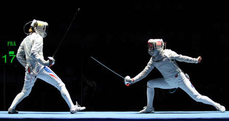 Women's national teams of France and Russia compete at the 2010 RFF Moscow Saber World Fencing Tournament, February 16, 2010 in Moscow, Russia. Stock Photo - 8868662