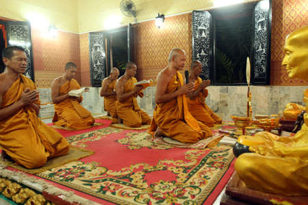 ordinate: KOH CHANG, THAILAND - DECEMBER 5: Recitation of mantras by monks in a Buddhist monastery Wat Klong Prao, on the occasion of the birth of King of Thailand, December 5, 2011 in Koh Chang, Thailand. Editorial