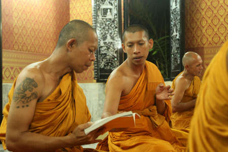 klong: KOH CHANG, THAILAND - DECEMBER 5: Recitation of mantras by monks in a Buddhist monastery Wat Klong Prao, on the occasion of the birth of King of Thailand, December 5, 2011 in Koh Chang, Thailand. Editorial