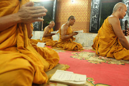 recitation: KOH CHANG, THAILAND - DECEMBER 5: Recitation of mantras by monks in a Buddhist monastery Wat Klong Prao, on the occasion of the birth of King of Thailand, December 5, 2011 in Koh Chang, Thailand. Editorial
