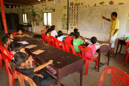 chang: KO CHANG, THAILAND - JANUARY 6: Unknown children in lesson at school by project Cambodian Kids Care to help deprived children in deprived areas with education, on January 6, 2012 on Ko Chang, Thailand