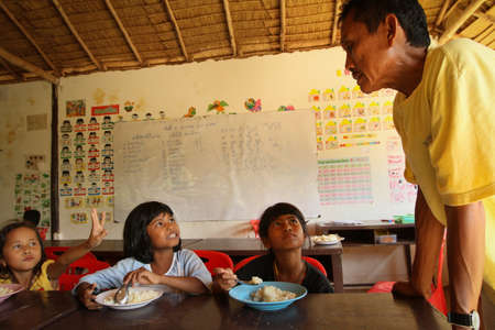 KO CHANG, THAILAND - JANUARY 6: Unknown children in the classroom at lunch time at school by project Cambodian Kids Care to help deprived children in deprived areas, on January 6, 2012 on Ko Chang, Thailand. Stock Photo - 12060987