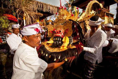 Melasti Ritual is performed before Nyepi - a Balinese Day of Silence that is commemorated every year (in 2012, it is on March 23rd) on March 18, 2012 in Ubud, Bali, Indonesia. Stock Photo - 12689971