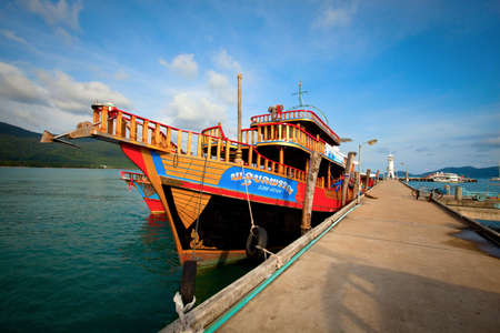 Old Thai ship at the pier on Koh Chang island Stock Photo - 13072346