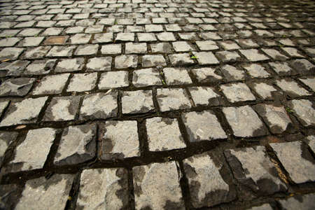 cobbled: Cobblestone road Stock Photo