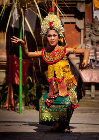 performs: BALI, INDONESIA - APRIL 9: Young girl performs a classic national Balinese dance Barong on April 9, 2012 on Bali, Indonesia. Barong is very popular cultural show on Bali.