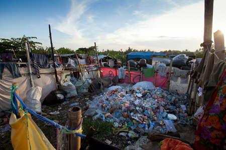BALI, INDONESIA - APRIL 11: Waste at the dump on Bali island  on April 11, 2012 on Bali, Indonesia. Bali daily produced 10,000 cubic meters of waste.