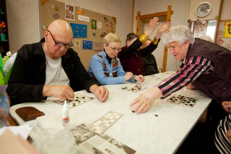 psychologic: PODPOROZHYE, RUSSIA - MAY 3: Day of Health in Center of social services for pensioners and disabled (Lotto - exercises for development of attention for eldery), May 3, 2012 in Podporozhye, Russia. Editorial