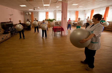PODPOROZHYE, RUSSIA - MAY 3: Day of Health in Center of social services for pensioners and the disabled Otrada (gymnastics with ball for eldery), May 3, 2012 in Podporozhye, Russia.