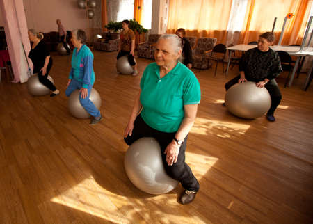 PODPOROZHYE, RUSSIA - MAY 4: Day of Health in Center of social services for pensioners and disabled Otrada (gymnastics with ball for eldery), May 4, 2012 in Podporozhye, Russia.   Stock Photo - 13574172
