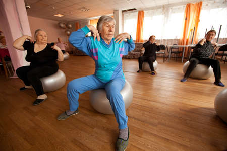 PODPOROZHYE, RUSSIA - MAY 4: Day of Health in Center of social services for pensioners and disabled Otrada (gymnastics with ball for eldery), May 4, 2012 in Podporozhye, Russia.   Stock Photo - 13574174