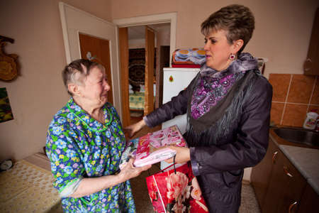 PODPOROZHYE, RUSSIA - MAY 5: In anticipation of the Day of Victory in Great Patriotic War, Center of social services for pensioners and disabled Otrada gives presents to War Veterans, May 5, 2012 in Podporozhye, Russia.