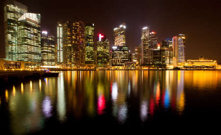 A view of Singapore business district in the night time with water reflections  Stock Photo - 13517410