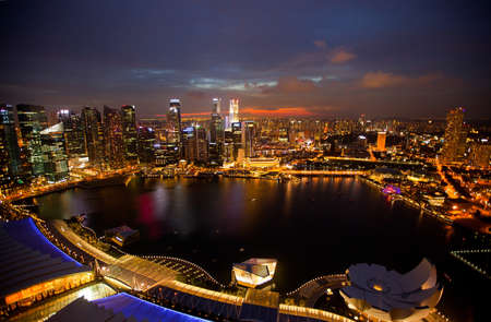 Night scene of financial district Singapore from roof Marina Bay Hotel  photo