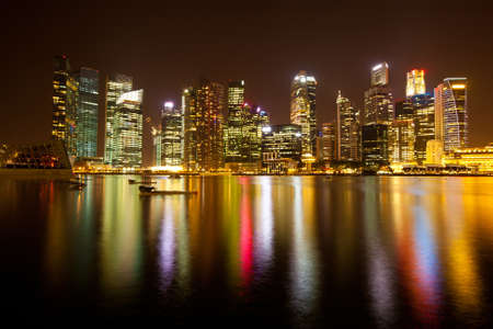 Singapore business district in the night time with water reflections Stock Photo - 13677180