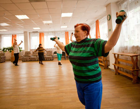 PODPOROZHYE, RUSSIA - MAY 3: Day of Health in Center of social services for pensioners and the disabled Otrada (gymnastics with sticks for eldery), May 3, 2012 in Podporozhye, Russia.