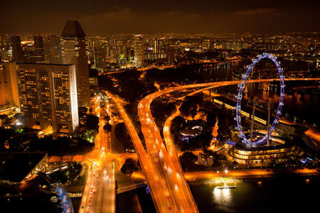 A view of Singapore from roof Marina Bay hotel in the night  photo