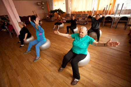 PODPOROZHYE, RUSSIA - MAY 4: Day of Health in Center of social services for pensioners and disabled Otrada (gymnastics with ball for eldery), May 4, 2012 in Podporozhye, Russia. Stock Photo - 13686484