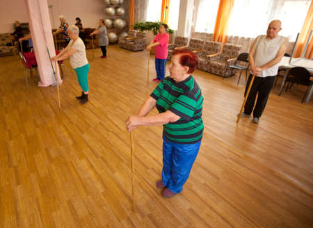 PODPOROZHYE, RUSSIA - MAY 3: Day of Health in Center of social services for pensioners and the disabled Otrada (gymnastics with sticks for eldery), May 3, 2012 in Podporozhye, Russia. Stock Photo - 13686451