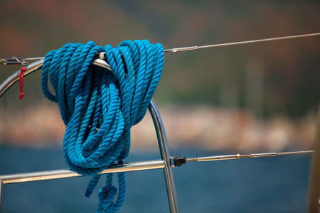Close-up of a mooring rope on a modern yacht, background image with space for text or logos. Stock Photo - 14064174