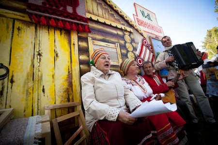 VINNICI, LENINGRAD REGION, RUSSIA - JUNE 10: Local people during celebrate the annual holiday Vepsian national culture Tree of Life (vepssk. Elo-pu), June 10, 2012 in the village Vinnici, Russia.