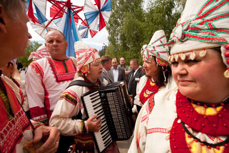 VINNICI, LENINGRAD REGION, RUSSIA - JUNE 10: Local people during celebrate the annual holiday Vepsian national culture Tree of Life (vepssk.Elo-pu), June 10, 2012 in the village Vinnici, Russia. Stock Photo - 14406740