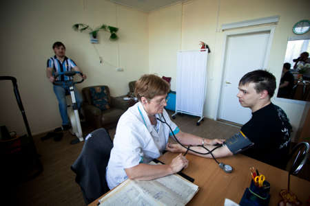 PODPOROZHYE, RUSSIA - JULY 3: Day of Health in Center of social services for pensioners and the disabled Otrada (Medical examination of disabled), July 3, 2012 in Podporozhye, Russia.