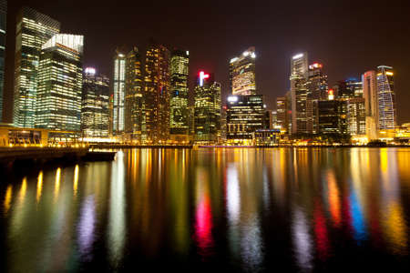 A view of Singapore business district in the night time with water reflections   Stock Photo - 14408082