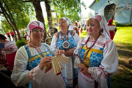 VINNICI, LENINGRAD REGION, RUSSIA - JUNE 10: Local people during celebrate the annual holiday Vepsian national culture Tree of Life (vepssk.Elo-pu), June 10, 2012 in the village Vinnici, Russia. Stock Photo - 14514781