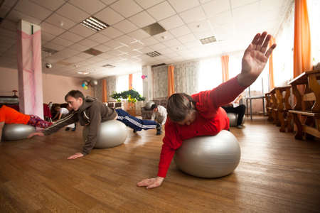 PODPOROZHYE, RUSSIA - JULY 5: Day of Health in Center of social services for pensioners and disabled Otrada (gymnastics with ball for eldery and disabled), July 5, 2012 in Podporozhye, Russia.