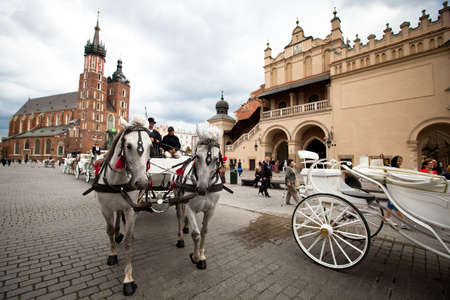 KRAKOW, POLAND - JULY 18: The historical center of Krakow, May 18, 2012 in Krakow, Poland. This year the city was visited by 8.1 million tourists, which is the highest level, foreign tourists - 2 million.