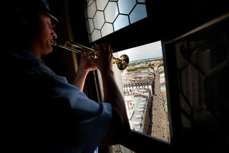 KRAKOW, POLAND - JULY 19: Heynal (St. Mary dawn) also known as the Cracovian Hymn played by a trumpeter from the highest tower of St. Mary Church, July 19, 2012 in Krakow, Poland.