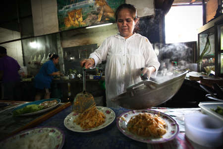 KO CHANG, THAILAND - JANUARY 6:  Unknown cooks prepare food at a thai restaurant on January 6, 2012 in Ko Chang, Thailand. Due to with tourist development in island since 2000 opens increasing number of restaurants.