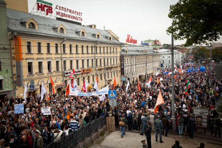 MOSCOW - SEPTEMBER 15: Opposition activists and supporters take part in an anti-Putin protest on September 15, 2012 in Moscow. Thousands marched through Moscow to protest against the rule of V.Putin. Stock Photo - 15239994