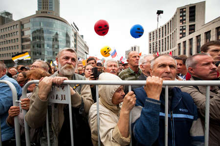 sentenced: MOSCOW - 15 SEPTEMBER: Opposition activists and supporters take part in an anti-Putin protest on September 15, 2012 in Moscow. Color balloons with the words Freedom to Pussy Riot refer to the three members of the punk band Pussy Riot sentenced to two year Editorial