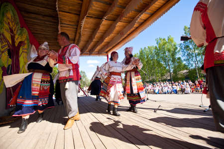 VINNICI, LENINGRAD REGION, RUSSIA - JUNE 10: Local people during celebrate the annual holiday Vepsian national culture Tree of Life (vepssk.Elo-pu), June 10, 2012 in the village Vinnici, Russia. Stock Photo - 15486441