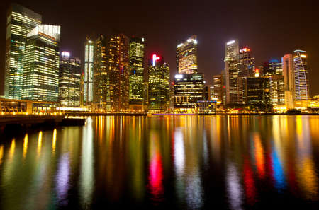 A view of Singapore business district in the night time with water reflections   Stock Photo - 15564957