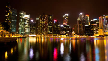 Singapore business district in the night time with water reflections. Stock Photo - 15588838