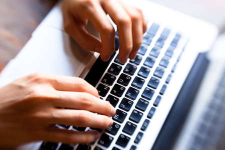 Hands typing on computer keyboard Stock Photo - 16482074